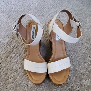 Steve Madden Cream leather straps with wood wedge.